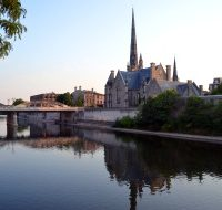 Building in Cambridge, Ontario, next to a river.