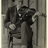 Mountain fiddler, circa 1920.