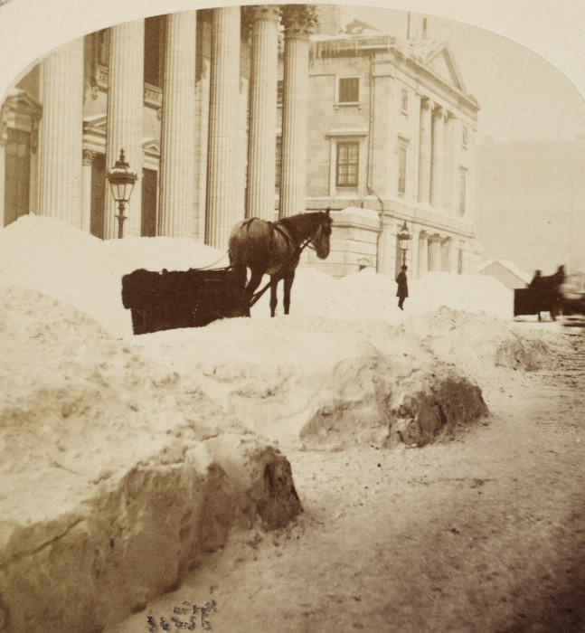 A photo by William Notman of a winter view of St. James (now Rue St-Jacques) in Montréal.