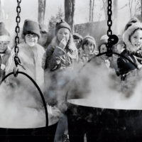 Eager students from Bolton public schools watch the process of boiling down maple sap into syrup.