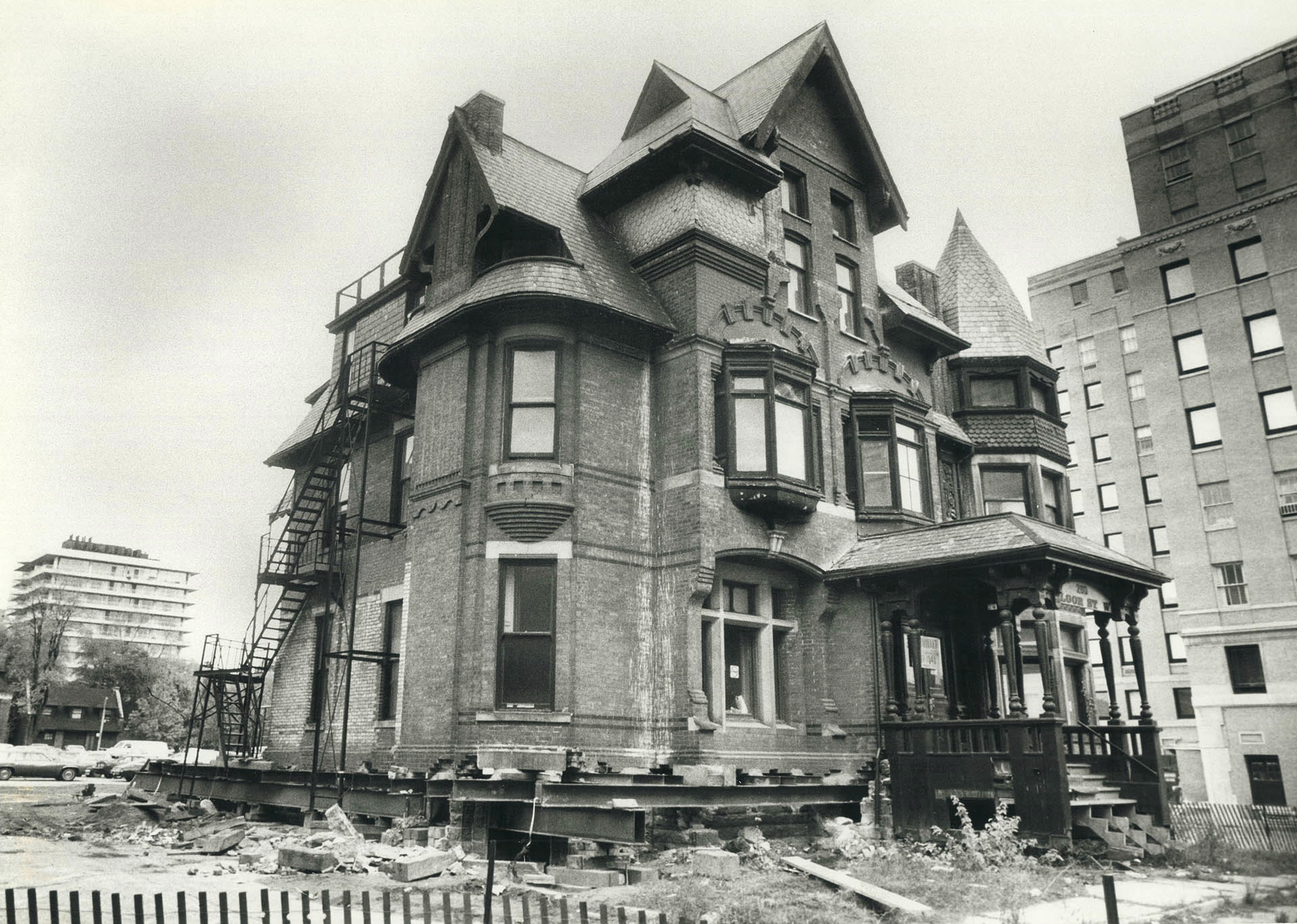 Historic James Crowther house raised 1.2 meters so it can be wheeled to a new location rather than be torn down.